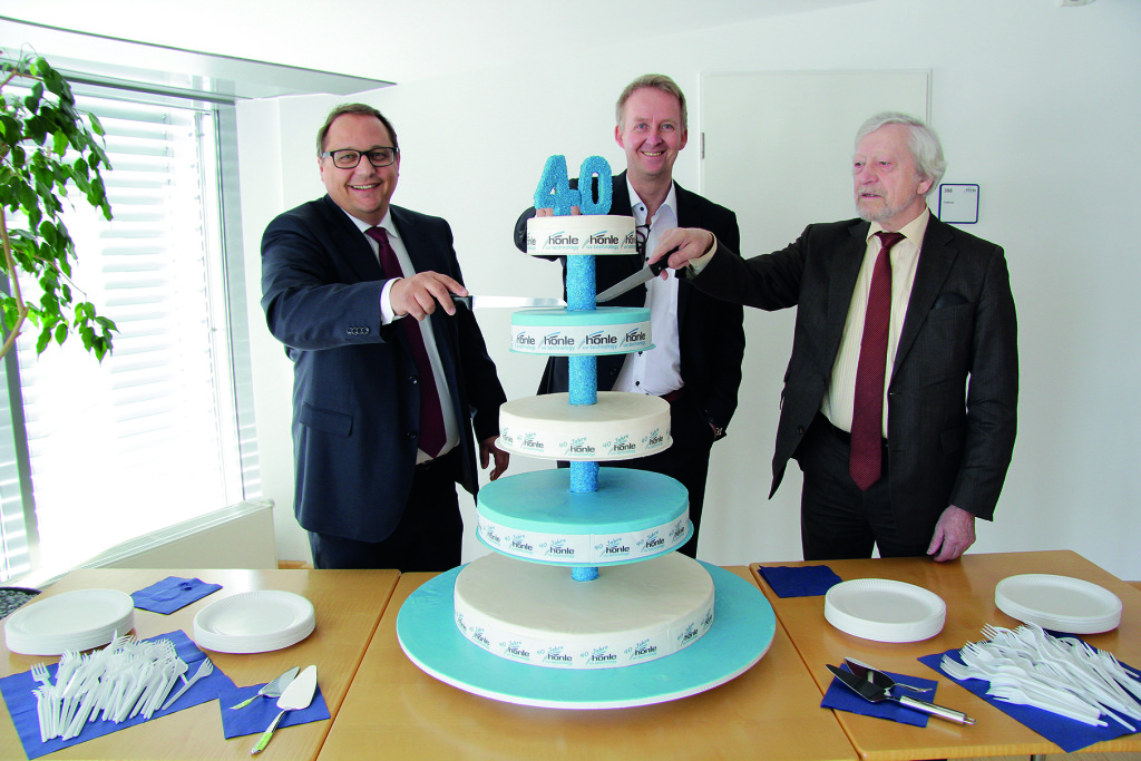 The cutting of the cake (L-R): The members of board Heiko Runge and Norbert Haimerl as well as founder of the company and chairman Prof. Dr. Karl Hönle