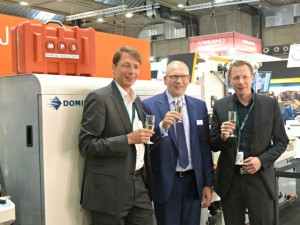First SYMJET Press sold to customer Optikett: Matthias and Daniel Ostendorf and Bert van Brink of MPS